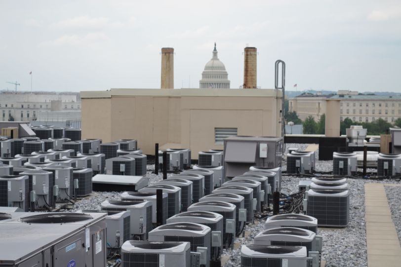 The call this the air conditioner farm, and beyond overlooks another neighbor, the U.S. Capitol.